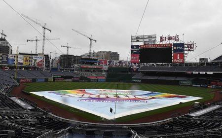 May 16, 2018; Washington, DC, USA; The tarp covers the field at Nationals Park. The games between the New York Yankees and Washington Nationals have been postponed until June 18, 2018. Mandatory Credit: Brad Mills-USA TODAY Sports