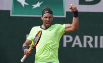 Spain's Rafael Nadal celebrates after defeating Britain's Cameron Norrie during their third round match on day 7, of the French Open tennis tournament at Roland Garros in Paris, France, Saturday, June 5, 2021. (AP Photo/Michel Euler)