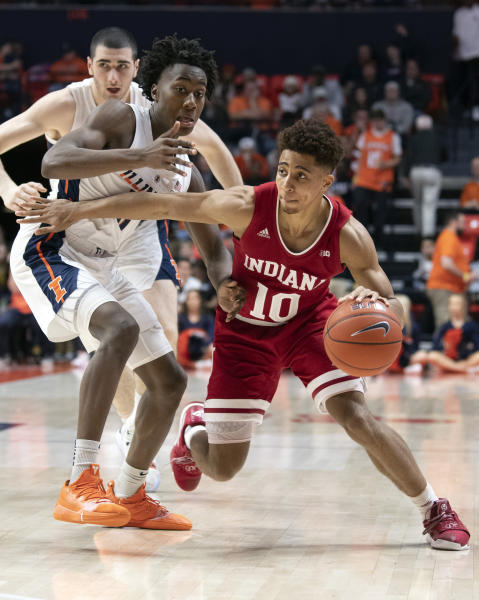 FILE - In this March 7, 2019, file photo, Indiana guard Rob Phinisee (10) drives to the basket against Illinois guard Ayo Dosunmu (11) during the second half of an NCAA college basketball game in Champaign, Ill. Phinisee understands the secret to being an effective point guard. He must find the proper balance between aggressive scorer and creative distributor while using his vision to help Indianas offense operate efficiently.(AP Photo/Stephen Haas, File)