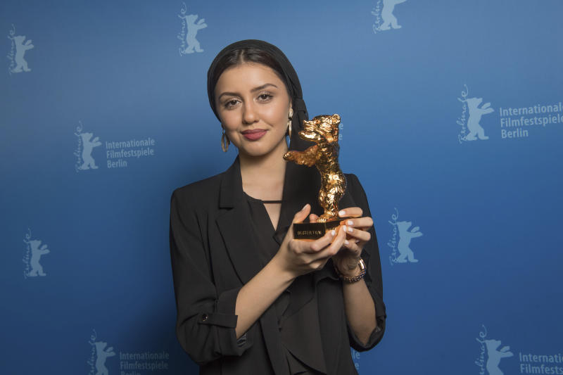 Actress Baran Rasoulof, holds The Golden Bear for Best Film in place of director Mohammad Rasoulof, who did not attend, for the film 'Sheytan vojud nadarad' (There Is No Evil) after the award ceremony at the 70th International Berlinale Film Festival in Berlin, Germany. Saturday, Feb. 29, 2020. (Joerg Carstensen/DPA via AP, Pool)