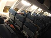The scene inside a plane from Kiev after it landed at Birmingham, having been diverted from Gatwick (@Christopher Lister/PA)