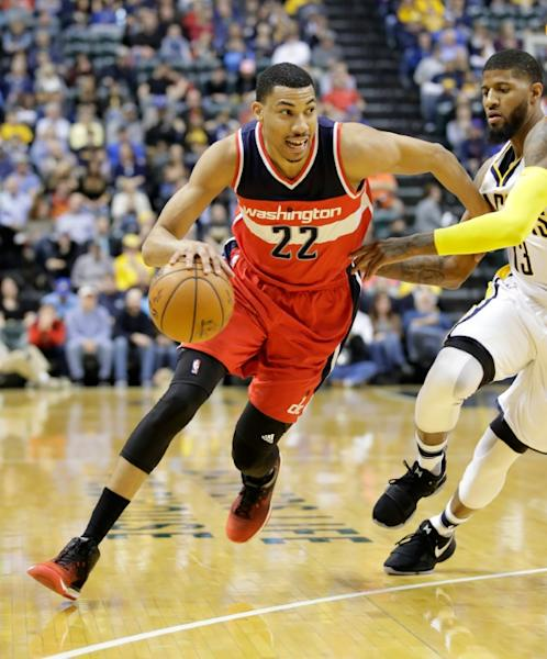 Otto Porter Jr (L) of the Washington Wizards, seen in action during their game against the Indiana Pacers, at Bankers Life Fieldhouse in Indianapolis, Indiana, on February 16, 2017