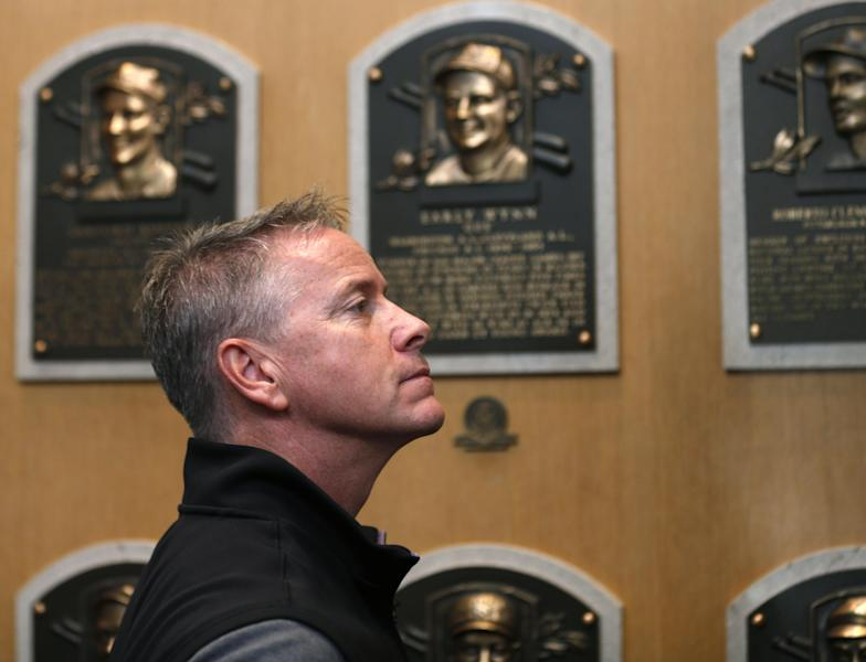 Former Atlanta Braves pitcher Tom Glavine visits the Plaque Gallery during his orientation visit at the Baseball Hall of Fame on Monday, March 17, 2014, in Cooperstown, N.Y. Glavine will be inducted to the hall in July. (AP Photo/Mike Groll)