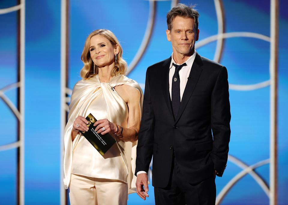 BEVERLY HILLS, CALIFORNIA: 78th Annual GOLDEN GLOBE AWARDS -- Pictured: (l-r) Kyra Sedgwick and Kevin Bacon speak onstage at the 78th Annual Golden Globe Awards held at The Beverly Hilton and broadcast on February 28, 2021 in Beverly Hills, California. -- (Photo by Christopher Polk/NBC/NBCU Photo Bank via Getty Images)
