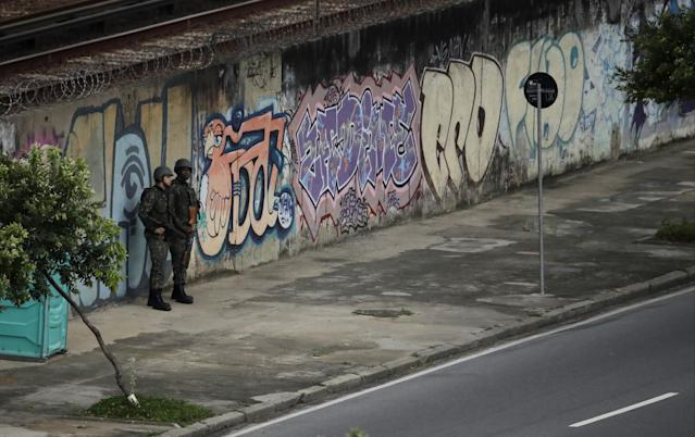 <p>Soldiers stand guard across the street from Maracana stadium, shortly before the closing ceremony for the Summer Olympics in Rio de Janeiro, Brazil, Sunday, Aug. 21, 2016. (AP Photo/Charlie Riedel) </p>