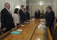 Russia's President Vladimir Putin (back) and other high-ranked officials observe a minute of silence for victims of the Malaysia Airlines Boeing 777 plane crash before a meeting on economic issues at the Novo-Ogaryovo state residence outside Moscow July 17, 2014. REUTERS/Alexei Druzhinin/RIA Novosti/Kremlin