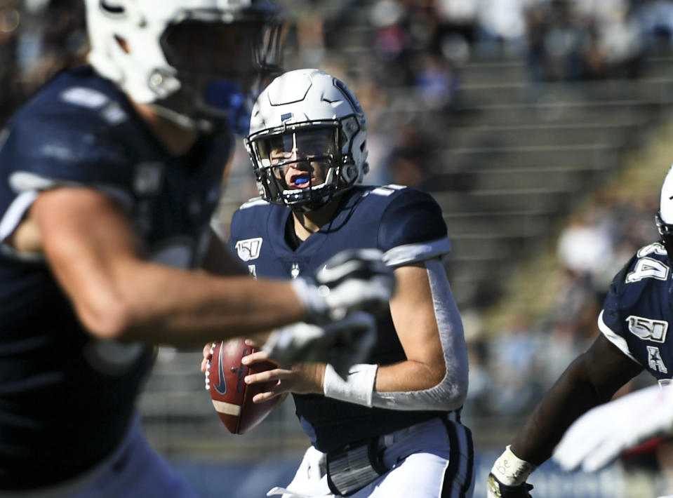 Connecticut quarterback Jack Zergiotis (11) sets to pass during the second half of an NCAA college football game against Houston Saturday, Oct. 19, 2019, in East Hartford, Conn. (AP Photo/Stephen Dunn)