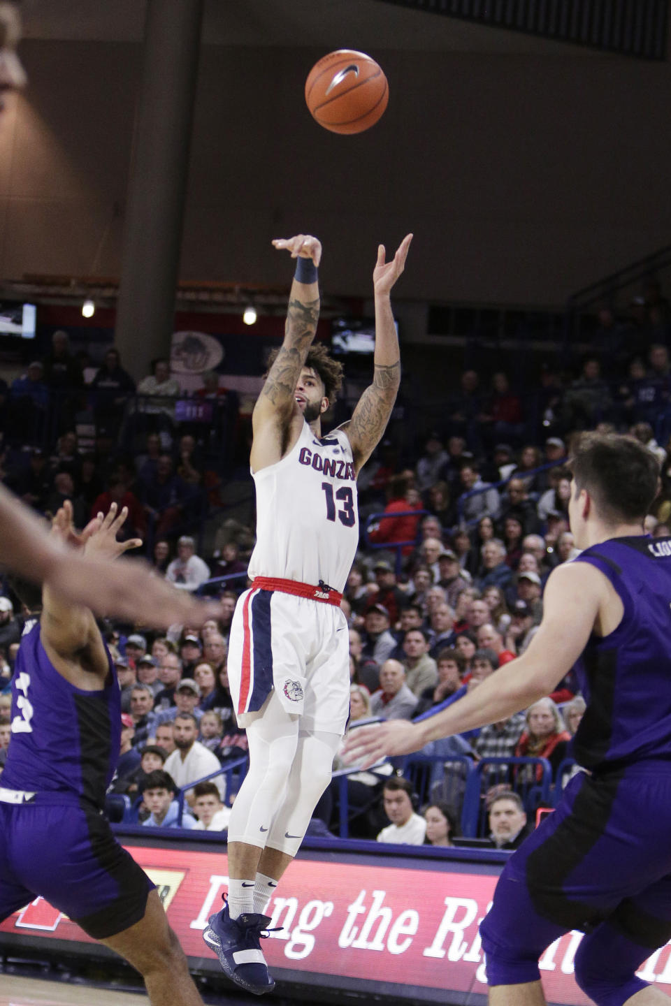 Gonzaga guard Josh Perkins (13) shoots in front of North Alabama guards Jamari Blackmon, left, and Aleksa Matic during the first half of an NCAA college basketball game in Spokane, Wash., Friday, Dec. 28, 2018. (AP Photo/Young Kwak)
