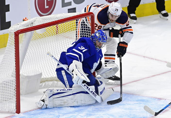 Edmonton Oilers' Leon Draisaitl (29) scores on Toronto Maple Leafs goaltender Frederik Andersen (31) during the second period of an NHL hockey game Friday, Jan. 22, 2021, in Toronto. (Frank Gunn/The Canadian Press via AP)