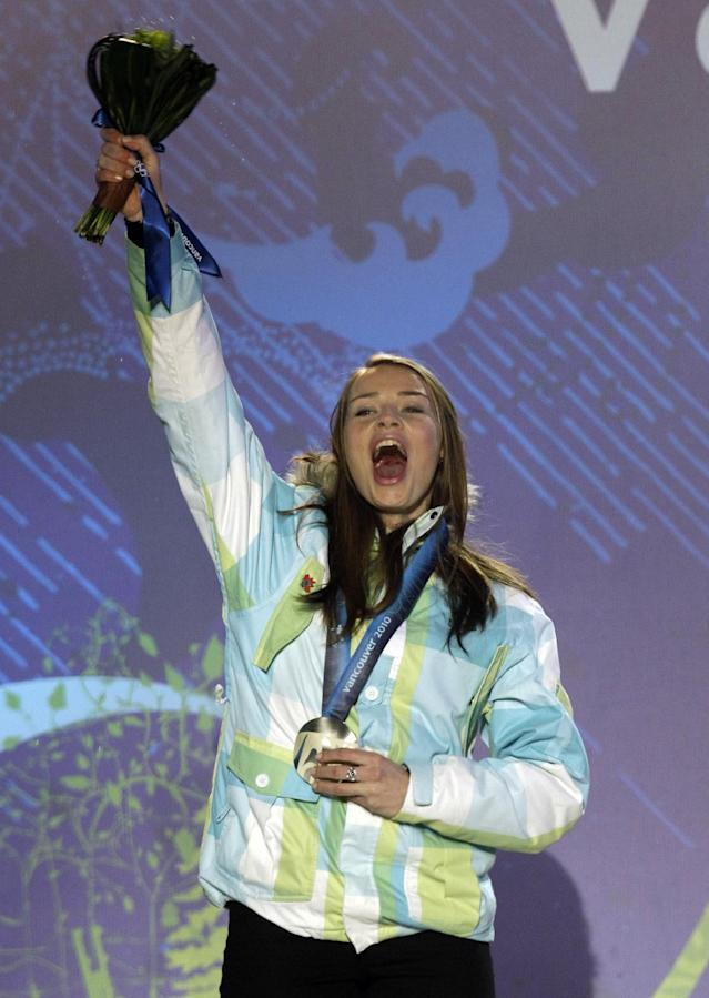 """FILE - In this Thursday, Feb. 25, 2010, file photo, silver medalist Tina Maze from Slovenia celebrates her medal for the women's giant slalom during the medal ceremony at the Vancouver 2010 Olympics in Whistler, British Columbia, Thursday, Feb. 25, 2010. The biggest puzzle in Alpine skiing approaching the Sochi Olympics was working out what happened to Tina Maze. After her historically good 2012-13 season, 11 World Cup wins, record points total, one world championships gold medal, the 30-year-old Slovenian fit perfectly as a potential Winter Games star. Maze celebrated victories with her exuberant trademark, a cartwheeling handspring across the snow. This season, she was clearly unhappy as her winless streak stretched into January, unwilling or unable to explain what she described in her blog as """"mediocre results."""" All that changed last Saturday, Jan. 25, 2014, when Maze raced to an elusive first win in a downhill at Cortina d'Ampezzo, Italy. (AP Photo/Michael Sohn, File)"""