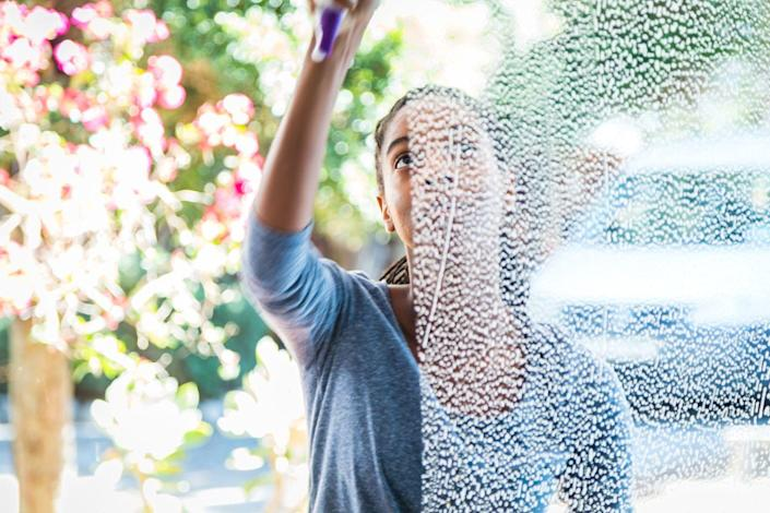 """<p>In order to <a href=""""https://www.goodhousekeeping.com/home/cleaning/tips/a32040/mistakes-cleaning-windows/"""" rel=""""nofollow noopener"""" target=""""_blank"""" data-ylk=""""slk:give your windows a streak-free shine"""" class=""""link rapid-noclick-resp"""">give your windows a streak-free shine</a>, you should ditch the squeegee. According to <em>Good Housekeeping</em>, start your window cleaning by sweeping dirt from the window frame with a brush or vacuum it up with an attachment. If your window screen looks a little grimy, pop it out and wash it with hot, soapy water and a soft brush, then rinse and let dry before putting it back.</p><p>To tackle the window glass, <em>Good Housekeeping</em> recommends using <a href=""""https://www.amazon.com/dp/B00KAON5Q2?linkCode=ogi&tag=goodhousekeeping_auto-append-20&ascsubtag=[artid