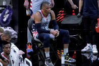 Washington Wizards guard Russell Westbrook (4) watches from the bench during the second half of an NBA basketball game against the Phoenix Suns, Saturday, April 10, 2021, in Phoenix. (AP Photo/Matt York)