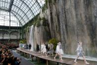 <p>For the SS18 show, the French fashion house further cemented its status as one of the most spectacular runways in the world with models stepping out beneath cascading waterfalls.<em> [Photo: Getty]</em> </p>