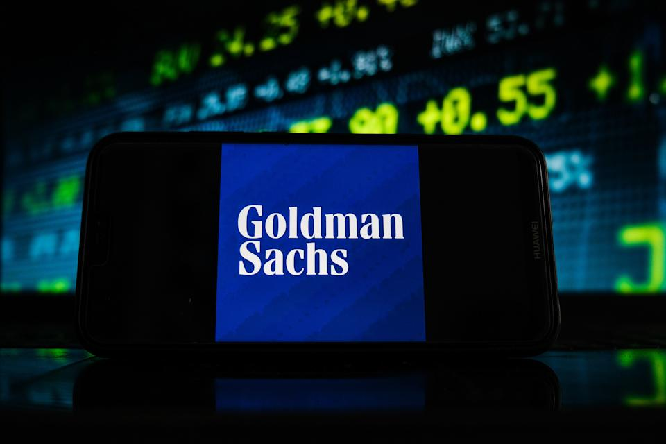 POLAND - 2021/02/07: In this photo illustration a Goldman Sachs logo seen displayed on a smartphone screen with stock market graphic on the background. (Photo Illustration by Omar Marques/SOPA Images/LightRocket via Getty Images)