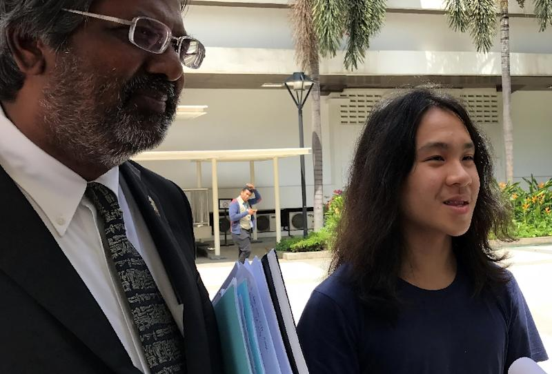 Out on bail, Singapore teen Amos Yee speaks to reporters outside court after he was jailed for six weeks for insulting Muslims and Christians on September 29, 2016