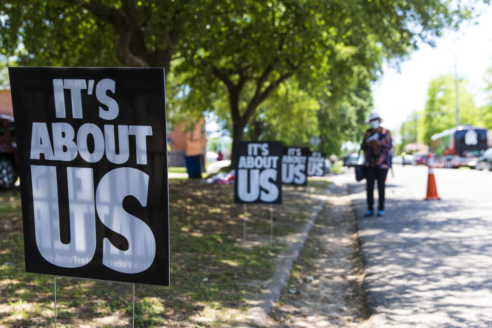 Signs supporting Black Voters Matter dot the road at Brown Chapel A.M.E. Church for the John Lewis Advancement Act Day of Action, a voter education and engagement event, Saturday, May 8, 2021, in Selma, Ala. (AP Photo/Vasha Hunt)