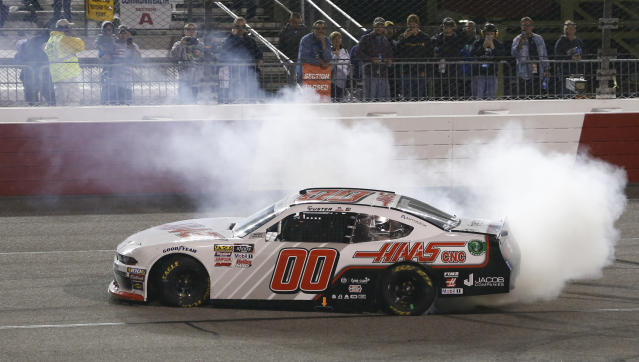 Cole Custer does a burnout as he celebrates winning the NASCAR Xfinity Series auto race at Richmond Raceway in Richmond, Va., Friday, April 12, 2019. (AP Photo/Steve Helber)