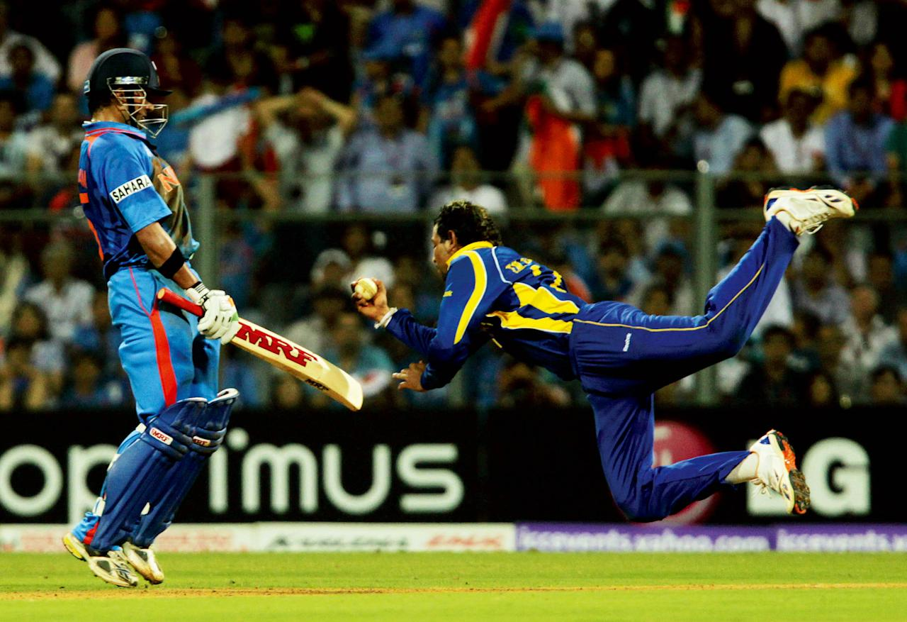 MUMBAI, INDIA - APRIL 2:  Tilakratne Dilshan (R) of Sri Lanka takes a catch off Indian batsman Virat Kohli during the 2011 ICC World Cup final between India and Sri Lanka at Wankhede stadium in Mumbai, India on April 2, 2011. (Photo by Manoj Patil/Hindustan Times via Getty Images)
