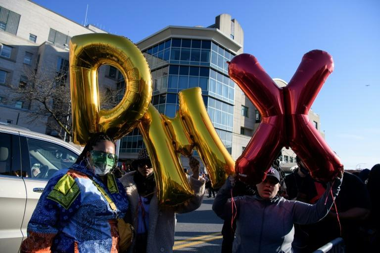 Fans of rapper DMX hold balloons as they attend a prayer vigil outside the hospital north of New York City where he is in critical condition following a heart attack
