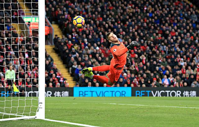 <p>Southampton goalkeeper Fraser Forster dives as Liverpool's Mohamed Salah scores his side's first goal of the game during the English Premier League soccer match Liverpool versus Southampton at Anfield, Liverpool, England, Saturday Nov. 18, 2017. (Peter Byrne/PA via AP) </p>