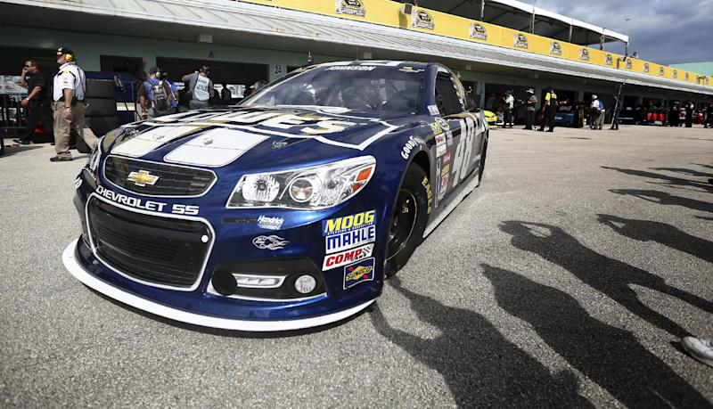 Jimmie Johnson leaves the garage during practice for Sunday's NASCAR Sprint Cup series auto race at the Homestead-Miami Speedway, Saturday, Nov. 16, 2013, in Homestead, Fla. (AP Photo/J Pat Carter)