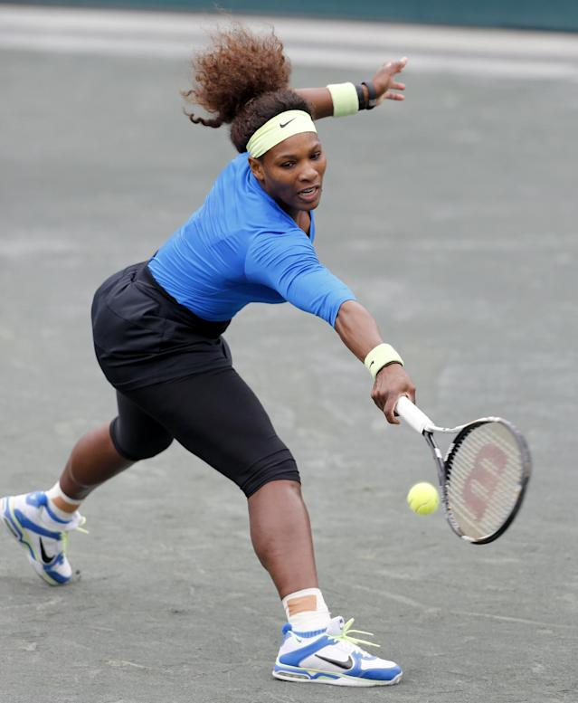 Serena Williams returns a shot to Sabine Lisicki, of Germany, during their quarterfinals match at the Family Circle Cup tennis tournament in Charleston, S.C., Friday, April 6, 2012. Lisicki later withdrew because of a sprained ankle. (AP Photo/Mic Smith)