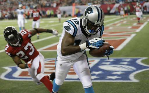 Carolina Panthers wide receiver Marvin McNutt (15) makes a catch out of bounds against Atlanta Falcons cornerback Robert Alford (23) during the first half of an NFL football game, Sunday, Dec. 29, 2013, in Atlanta. (AP Photo/John Bazemore)