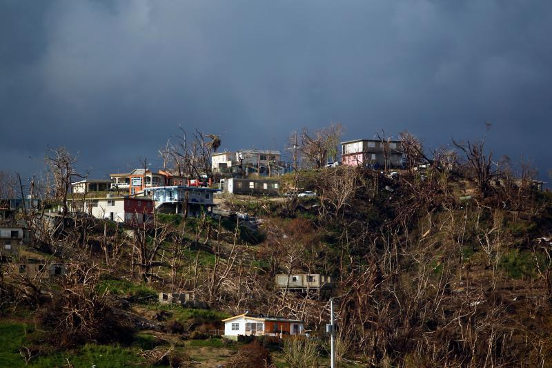 Damaged houses are seen atop a hill in the aftermath of Hurricane Maria in Yabucoa, Puerto Rico, on Oct. 2, 2017. (RICARDO ARDUENGO via Getty Images)