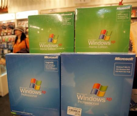 Microsoft Corp's Windows XP software products are displayed at a shop in Seoul.