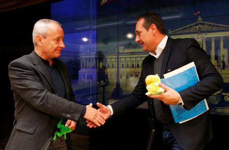 Greens lawmaker Pilz and FPOe leader Strache shake hands after a news conference in Vienna