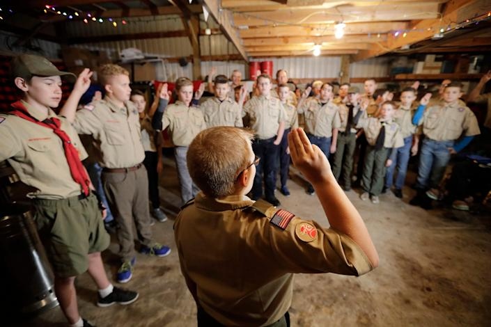 In this Thursday, Dec. 12, 2019 photo, a Boy Scouts troop gathers during their meeting, in Kaysville, Utah.
