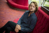 """Tobias Nierop, who plays soccer legend Johan Cruyff, poses for a portrait during a presentation of """"14 The Musical"""" in Leusden, Netherlands, Friday, June 11, 2021. On the opening day of the pandemic-delayed European 2020 Soccer Championship, the cast and crew of """"14 The Musical"""", referring to Cruyff's shirt number, raised the curtain on the new musical eulogizing the country's most famous footballing son, Johan Cruyff. (AP Photo/Peter Dejong)"""