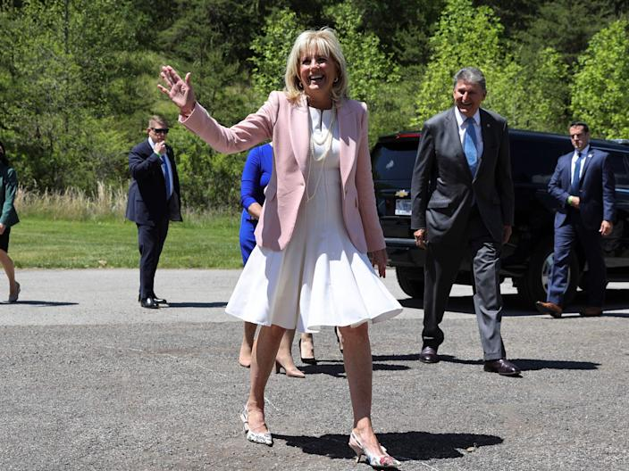 US First Lady Jill Biden waves as she greet members of the West Virginia National Guard (POOL/AFP via Getty Images)
