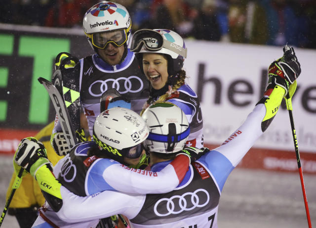 The Swiss team celebrates winning the gold medal in the finish area during the team event, at the alpine ski World Championships in Are, Sweden, Tuesday, Feb. 12, 2019. (AP Photo/Marco Trovati)