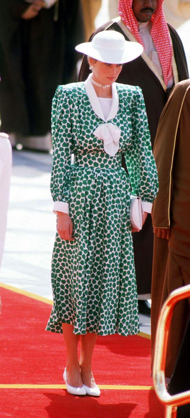 <p>In a Catherine Walker dress and white shoes, hat and clutch while arriving in Saudi Arabia. </p>