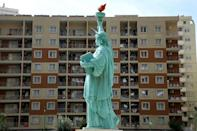 The exiles living at the expense of US NGOs and the Albanian government -- in a hotel featuring a replica of the Statue of Liberty (AFP/Gent SHKULLAKU)