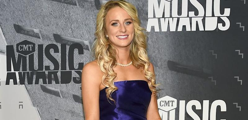 Leah Messer poses in a blue dress