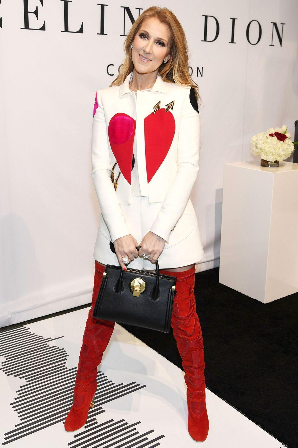 <p>In an Elsa Schiaparelli couture look and red suede over-the-knee boots while promoting her accessories collection in Las Vegas. </p>