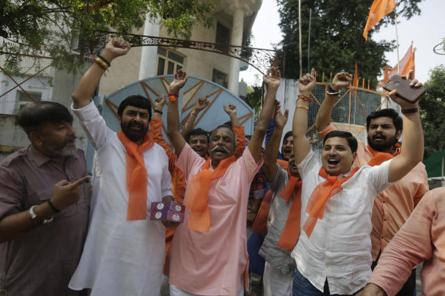 Supporters of Vishwa Hindu Parishad (VHP) or World Hindu council celebrate the Supreme Court's verdict, outside the VHP office in Ahmadabad, India, Saturday, Nov. 9, 2019. India's Supreme Court has ruled in favor of a Hindu temple on a disputed religious ground and ordered that alternative land be given to Muslims. The dispute over land ownership has been one of the country's most contentious issues. (AP Photo/Ajit Solanki)