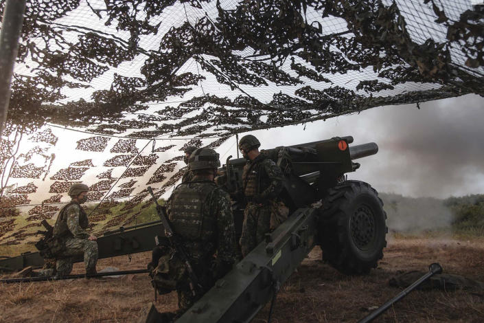 In this photo released by the Taiwan Military News Agency, a Taiwan artillery unit conducts a live firing drill to deter a coastal landing force during the Han Guang exercise held on the island of Penghu county, Taiwan, Wednesday, Sept. 15, 2021. Taiwan's annual five-day Han Guang military exercise is designed to prepare the island's forces for an attack by China, which claims Taiwan as part of its own territory. (Military News Agency via AP)
