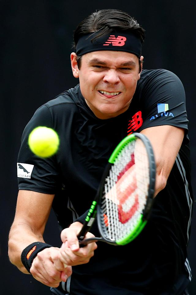 Tennis - ATP 250 - Stuttgart Open - Tennis Club Weissenhof, Stuttgart, Germany - June 17, 2018 Canada's Milos Raonic in action during the final against Switzerland's Roger Federer REUTERS/Ralph Orlowski
