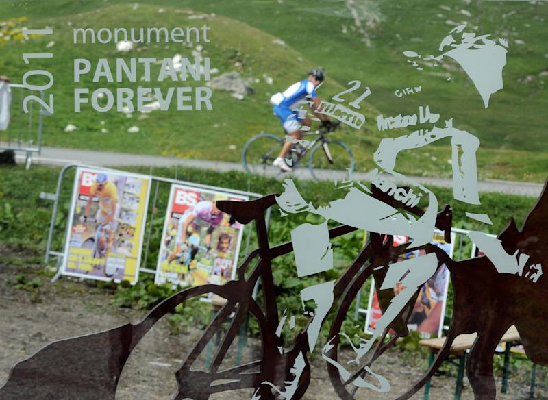 A cyclist is pictured through a memorial dedicated to late Italian cyclist Marco Pantani, on June 19, 2011 in the French village of Valloire (AFP Photo/Jean-Pierre Clatot)