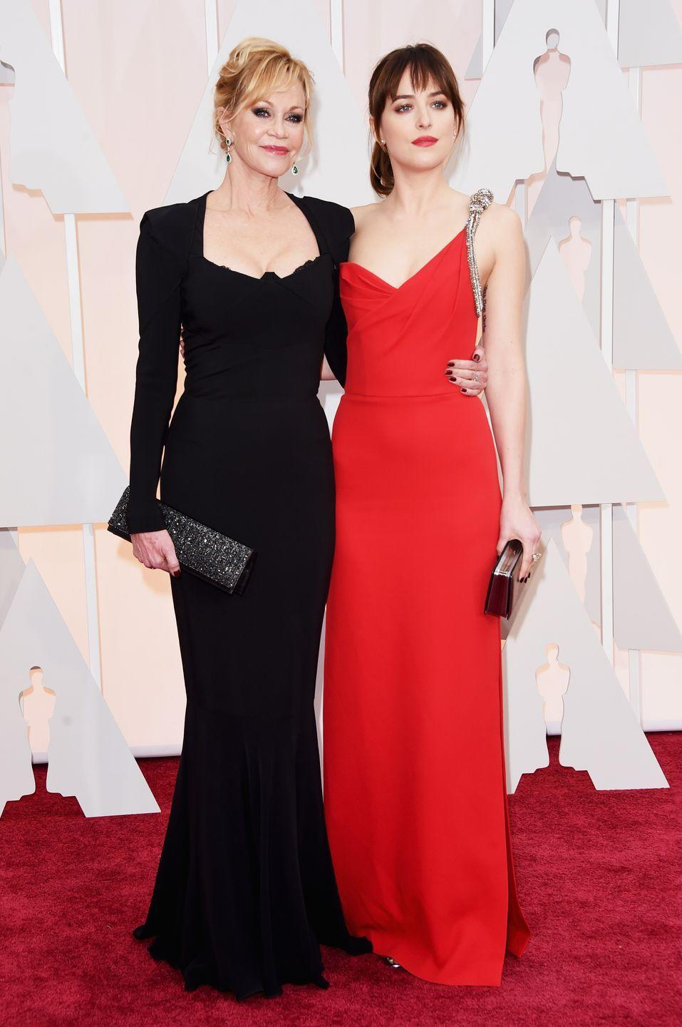 <p>Melanie Griffith's eldest daughter with Don Johnson, Dakota Johnson, strongly resembles both her famous parents. Despite their contrasting hair colors, the mom-and-daughter duo especially look strikingly similar. </p>