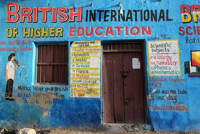 <p>A mural illustrating educational classes is seen on the outside of a building in Wabari district of Mogadishu, Somalia, June 10, 2017. (Photo: Feisal Omar/Reuters) </p>