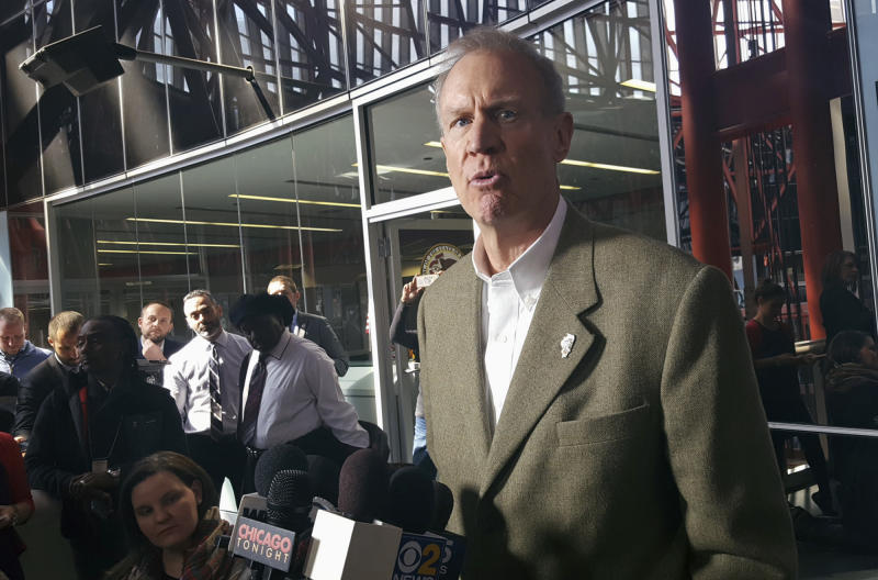 Illinois Gov. Bruce Rauner talks with reporters at the Thompson Center in Chicago, Friday, March 3, 2017, after his meeting with Grammy-winning artist Chance the Rapper. (AP Photo/Sophia Tareen)