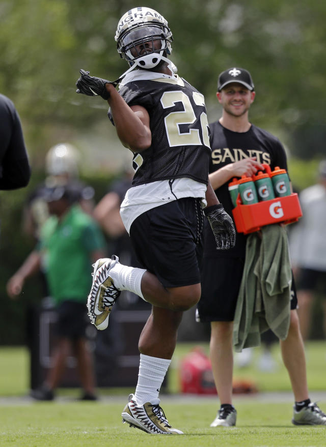 New Orleans Saints running back Mark Ingram II (22) dances to blasting music on the field during NFL football practice in Metairie, La., Tuesday, June 12, 2018. (AP Photo/Gerald Herbert)