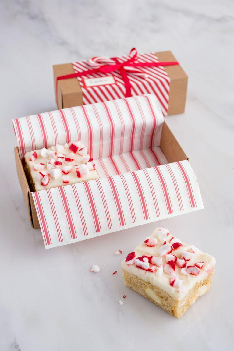 """<p>White chocolate and peppermint combine for a divine <a href=""""https://www.countryliving.com/diy-crafts/tips/g645/crafty-christmas-presents-ideas/"""" rel=""""nofollow noopener"""" target=""""_blank"""" data-ylk=""""slk:DIY Christmas gift"""" class=""""link rapid-noclick-resp"""">DIY Christmas gift</a> that's sure to delight.</p><p><strong><a href=""""https://www.countryliving.com/food-drinks/recipes/a36897/white-chocolate-peppermint-blondies/"""" rel=""""nofollow noopener"""" target=""""_blank"""" data-ylk=""""slk:Get the recipe"""" class=""""link rapid-noclick-resp"""">Get the recipe</a>.</strong></p><p><strong><strong><a class=""""link rapid-noclick-resp"""" href=""""https://www.amazon.com/s/ref=nb_sb_noss_2?url=search-alias%3Daps&field-keywords=Paper-Mache+box&tag=syn-yahoo-20&ascsubtag=%5Bartid%7C10050.g.1059%5Bsrc%7Cyahoo-us"""" rel=""""nofollow noopener"""" target=""""_blank"""" data-ylk=""""slk:SHOP PAPER BOXES"""">SHOP PAPER BOXES</a></strong><br></strong></p>"""