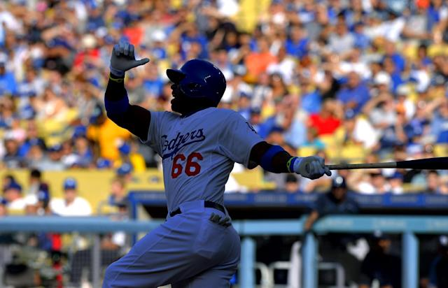 Los Angeles Dodgers' Yasiel Puig swings during the first inning of their baseball game against the Tampa Bay Rays, Sunday, Aug. 11, 2013, in Los Angeles. (AP Photo/Mark J. Terrill)