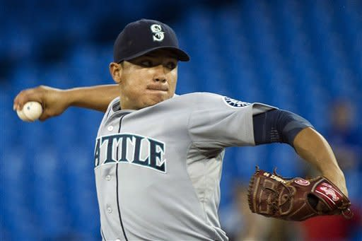 Seattle Mariners starting pitcher Erasmo Ramirez works against the Toronto Blue Jays during the first inning of a baseball game, Tuesday, Sept. 11, 2012, in Toronto. (AP Photo/The Canadian Press, Nathan Denette)