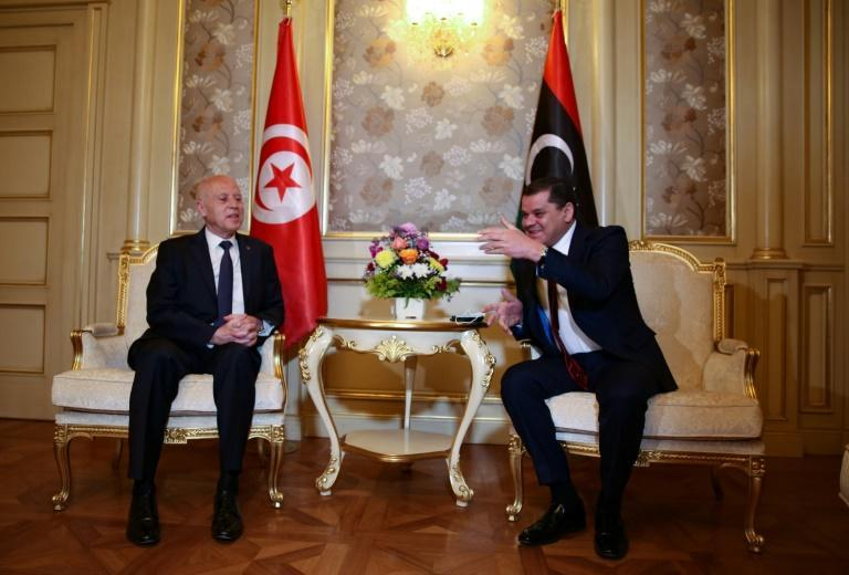 Tunisian President Kais Saied (L) meets with Libya's new interim Prime Minister Abdul Hamid Dbeibah, in the Libyan capital Tripoli, on March 17, 2021